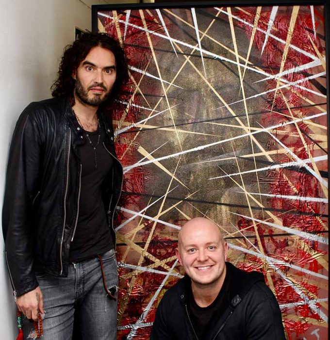 Lincoln Townley presents oil painting portrait to Russell Brand