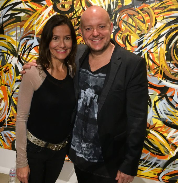 Rebecca Brando pictured with British artist Lincoln Townley. Lincoln Townley had created a collection of Iconic portraits of great actor past and Rebeccas father the late Marlon Brando was one of them. This photo was taken on the evening of Townley presenting her with the portrait.