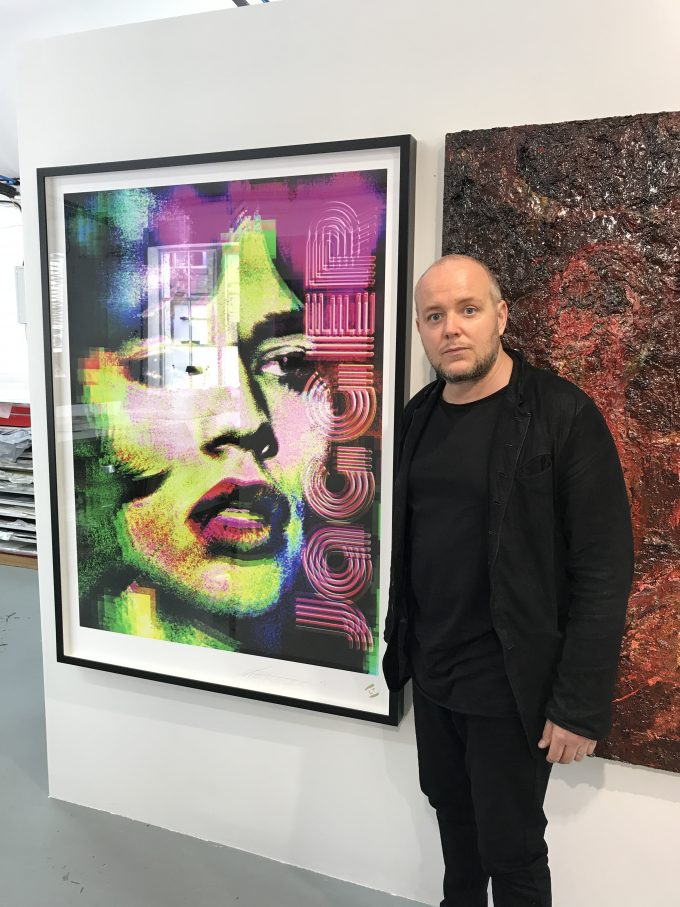 British artist Lincoln Townley with the new portrait of Mick Jagger