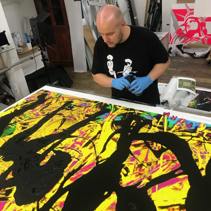 Portraits being created in the studio, British artist Lincoln Townley inspects the works