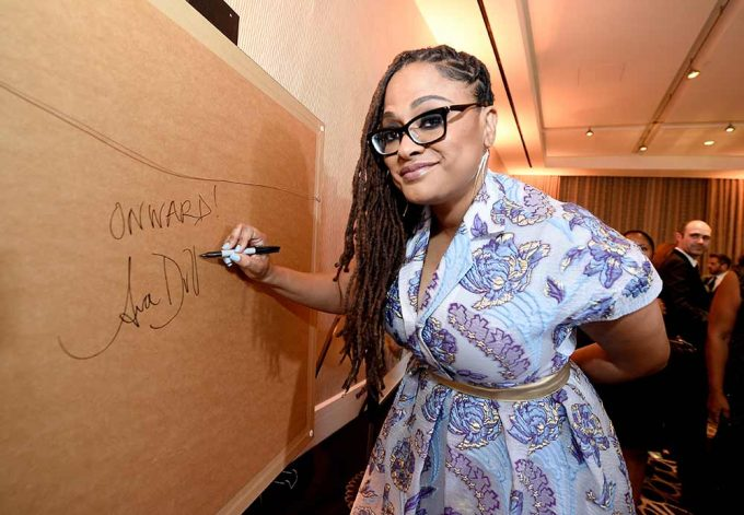 Movie director Ava Duvernay signs her abstract portrait created by British artist Lincoln Townley