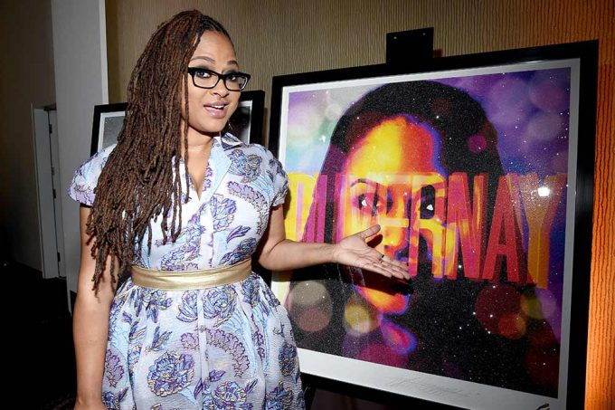 Film director Ava Duvernay seen here pointing out here portrait by British artist Lincoln Townley