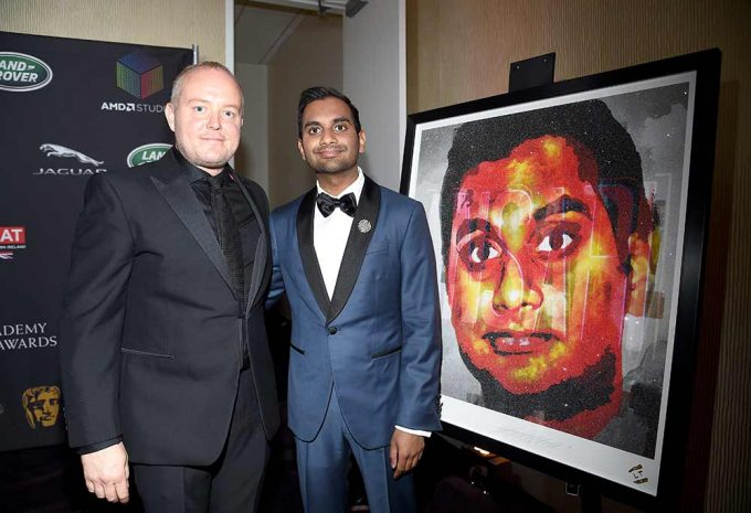 Comedy actor Aziz Ansari pictured with his portrait by British artist Lincoln Townley. Created for the Britannia awards for Bafta LA