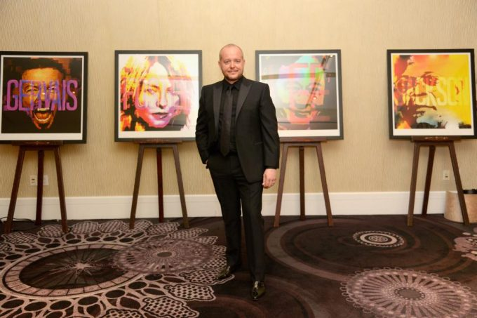 Lincoln Townley with his ICONS portraits at BAFTA LA