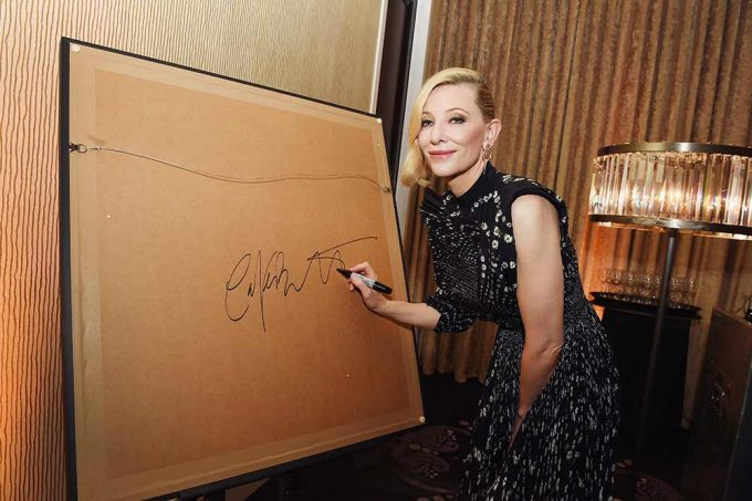 Cate Blanchett signing her picture for Bafta LA