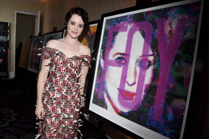 Actor Claire Foy stands with her abstract portrait created by British artist Lincoln Townley