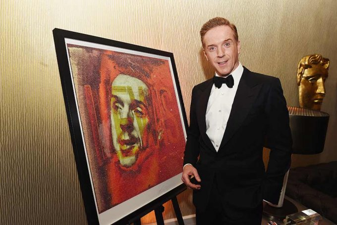 Actor Damian Lewis seen here with the portrait created by British artist Lincoln Townley