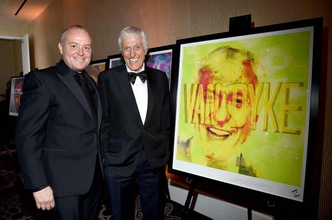 Comedy legend Dick Van Dyke and British artist Lincoln Townley stand with the portrait created by Townley
