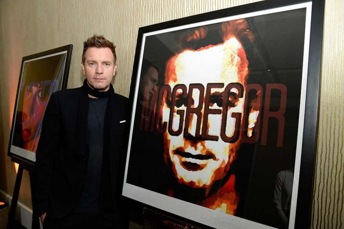 Actor Ewan McGregor stands with the abstract portrait created by the British artist Lincoln Townley