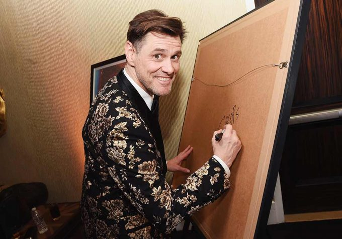 Jim Carrey signing the abstract portrait by British artist Lincoln Townley