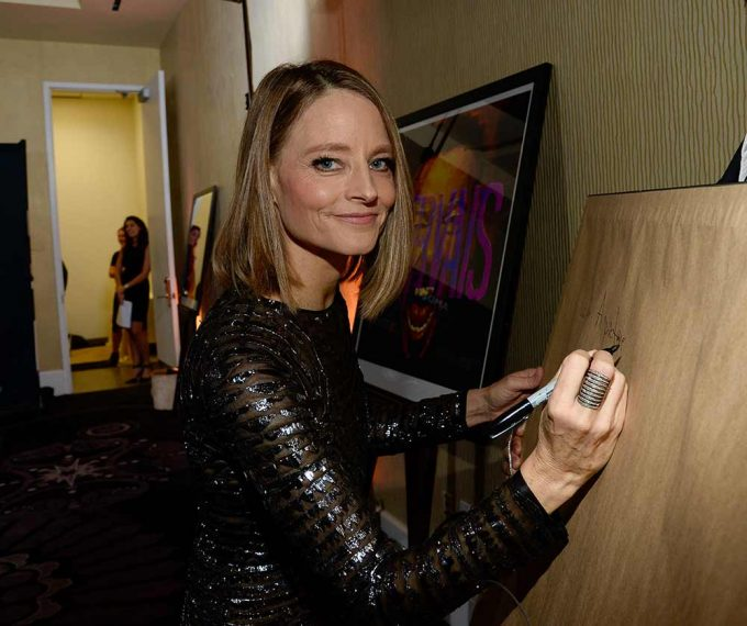 Actor and Director Jodie Foster signing her portrait by British artist Lincoln Townley