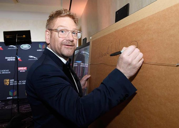 Sir Kenneth Branagh signing the portrait created by British artist Lincoln Townley