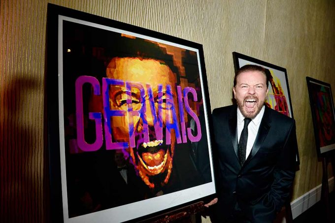 Comedy genius Ricky Gervais standing with his abstract portrait created by British artist Lincoln Townley