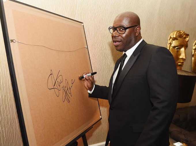 Film Director Steve McQueen signing his portrait created by Lincoln Townley